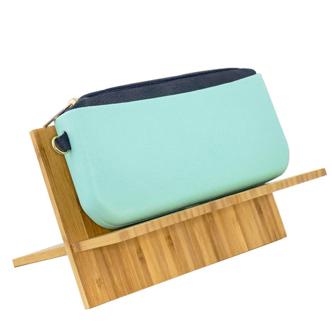 Evolution Smart Bag clutch bag on the wireless bamboo charging base