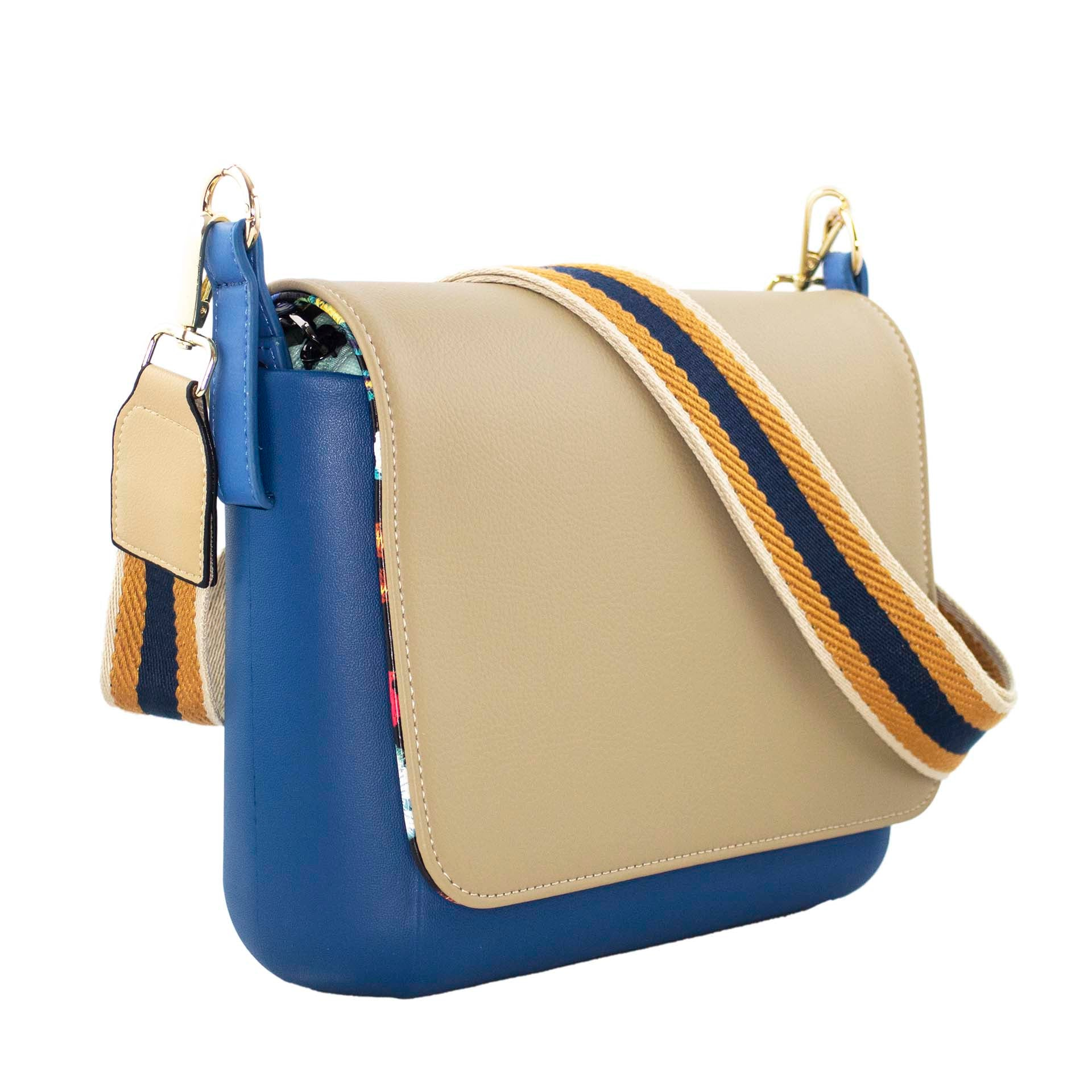 Beige and blue crossbody purse with interchangeable pieces and built-in wireless charging.
