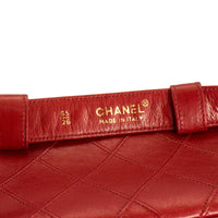 CHANEL Red leather waist purse, fanny pack bag with gold CC closure and chain Belt