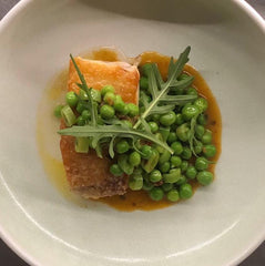 FODMAP gluten free recipe. fish with green peas in a bowl with NOGO sauce