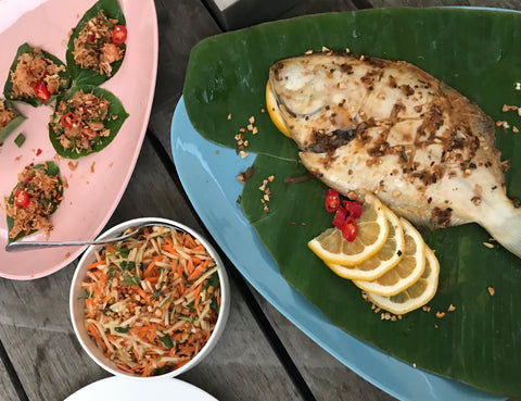 NOGO Sauces FODMAP recipe. Baked whole fish on banana leaf with green papaya salad.
