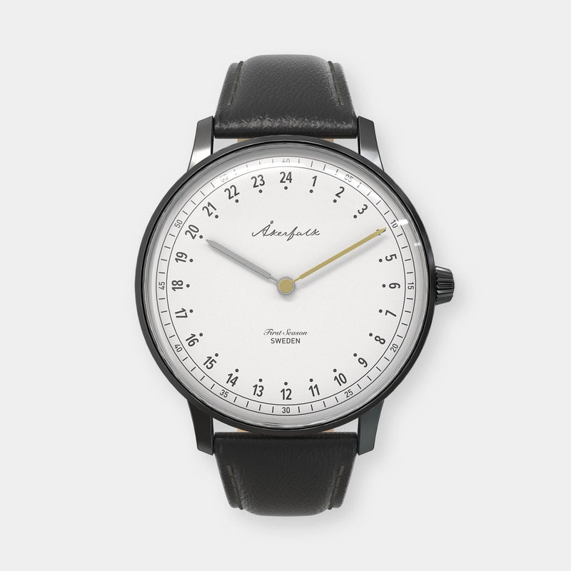 24-hour watch with matte black case and black leather strap