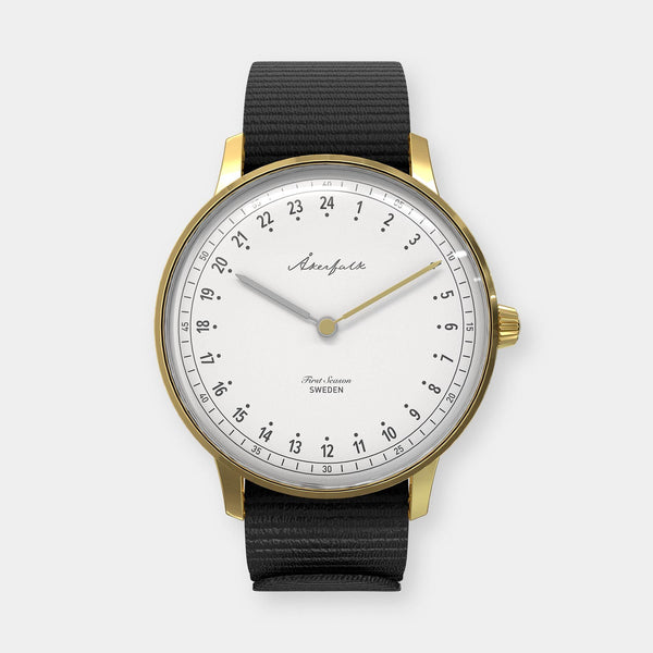 24-hour watch with gold case and black NATO strap