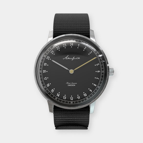 24-hour watch with silver case and black NATO strap