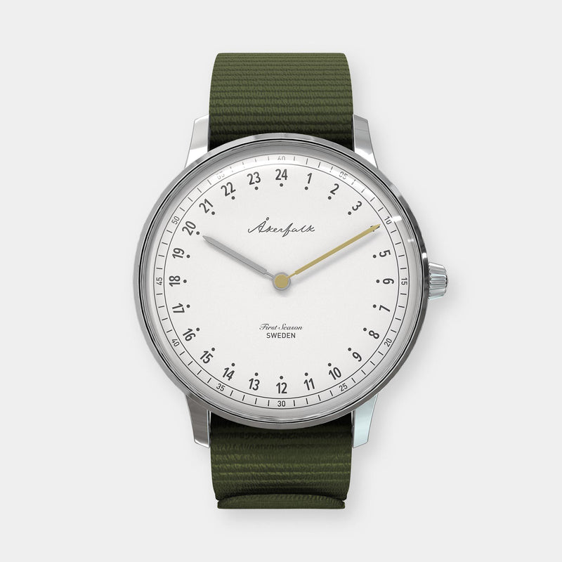24-hour watch with silver case and green NATO strap