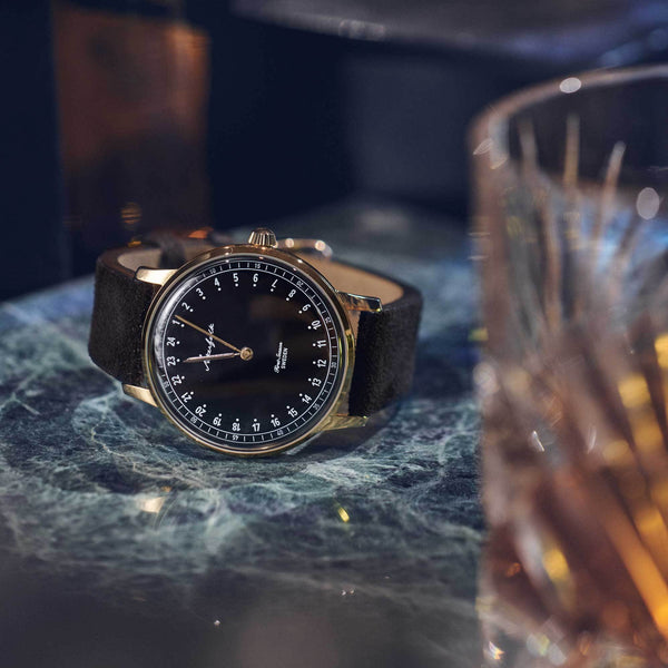 24-hour watch with gold case and black mocha strap