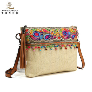 Women's embroidered envelope style straw cross body bag
