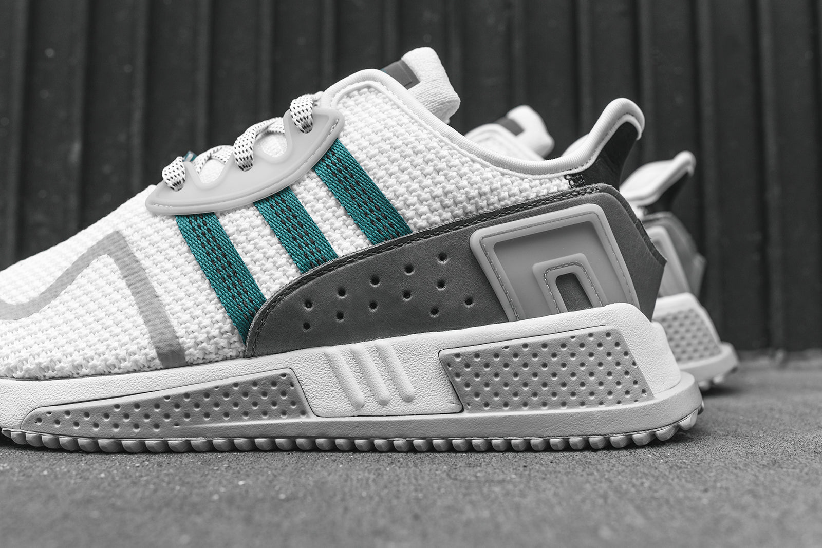 adidas Originals releases the all-new EQT Cushion ADV silhouette executed  in a White   Green   Grey makeup. This model features a fully breathable  premium ... add215ecb