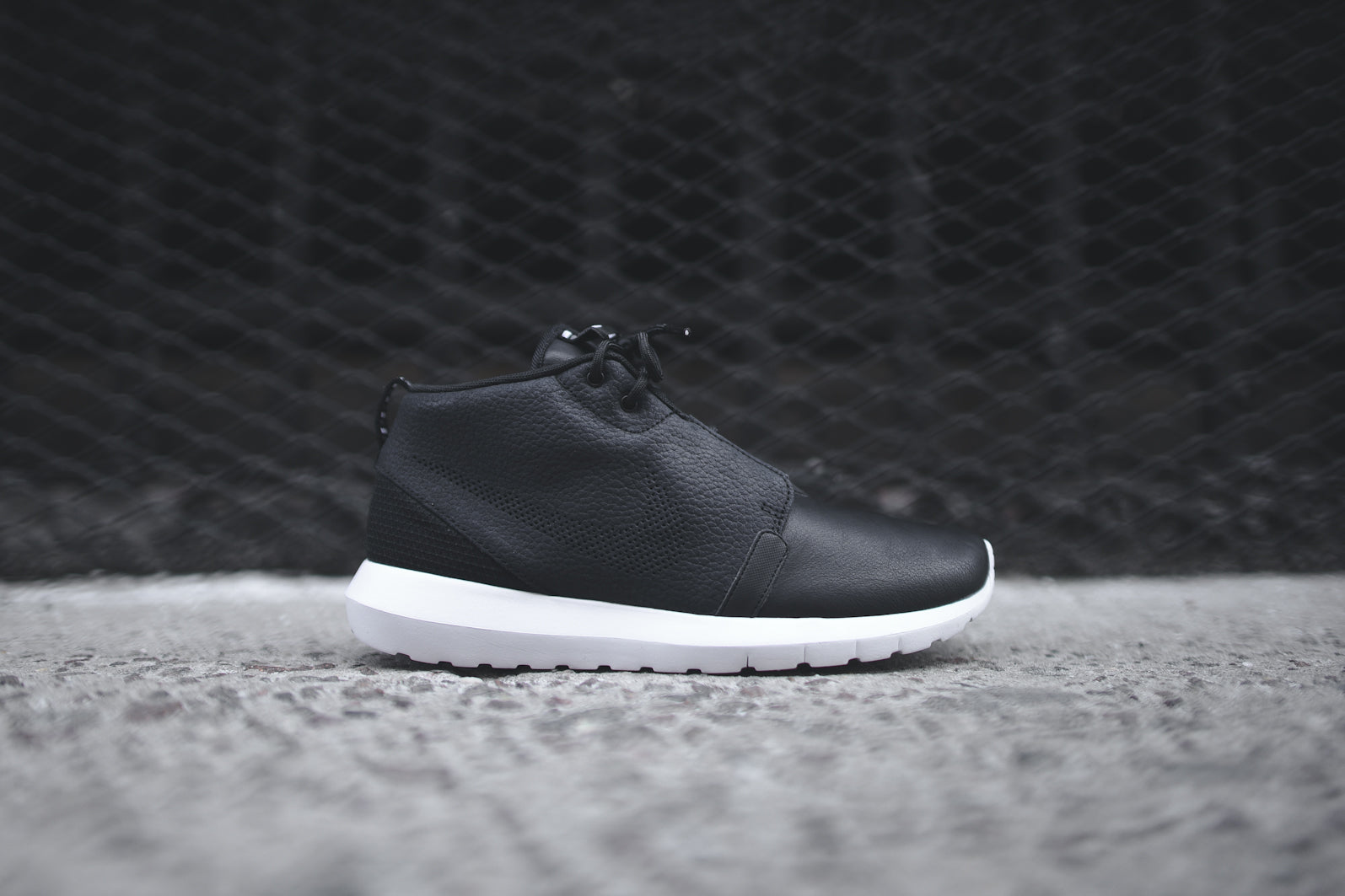 3e13baeb0c1f The NIKE Roshe Run NM Sneakerboot - Black   Dark Grey   White is available  now for email order at KITH Manhattan and KITH Brooklyn.