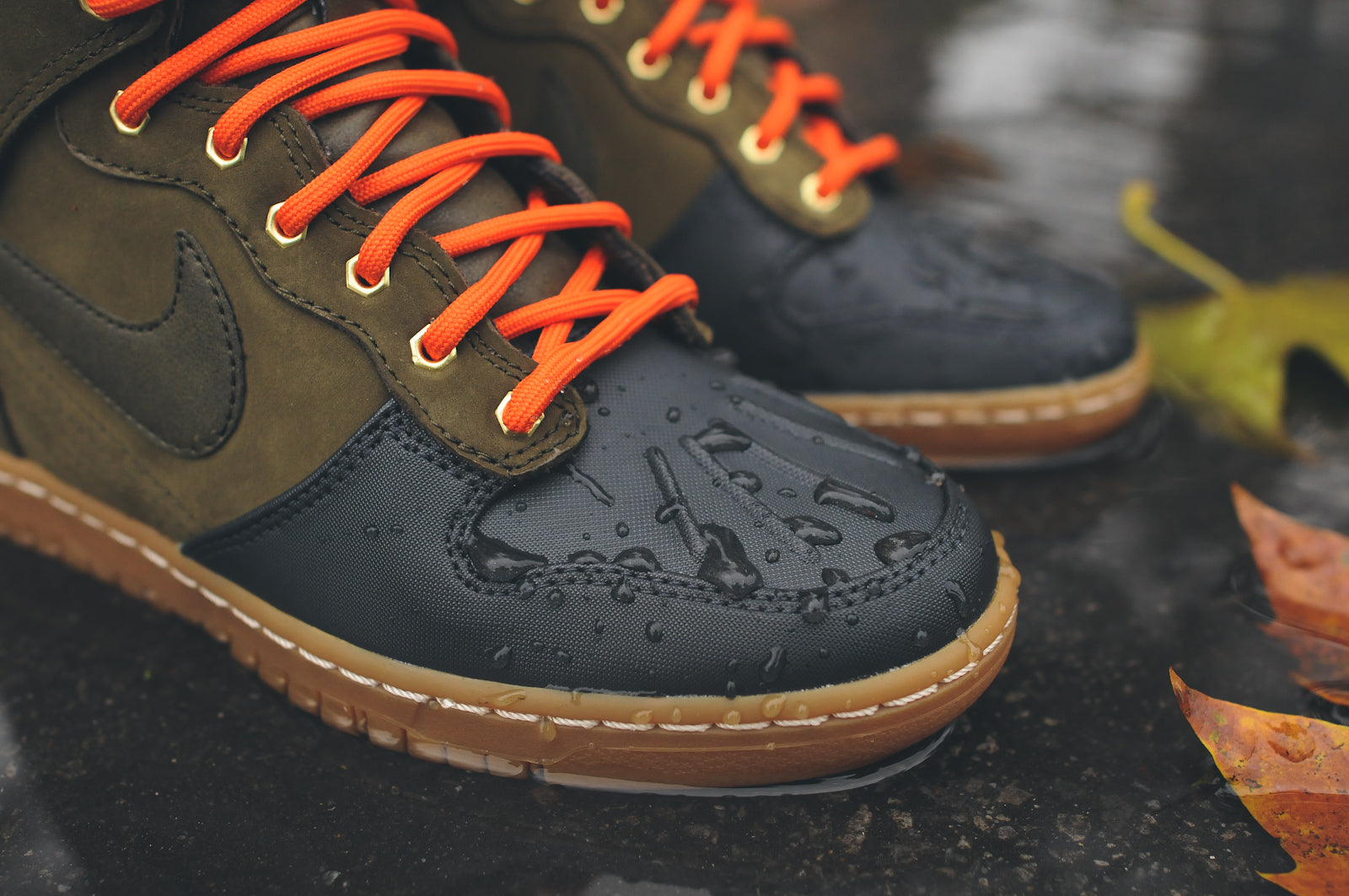 save off b9979 6ac04 Thus far, the third of its kind to arrive at KITH NYC is the NIKE WMNS Dunk  Sky Hi Sneakerboot 2.0 - Dark Loden/Black. Featuring the same silhouette as  its ...
