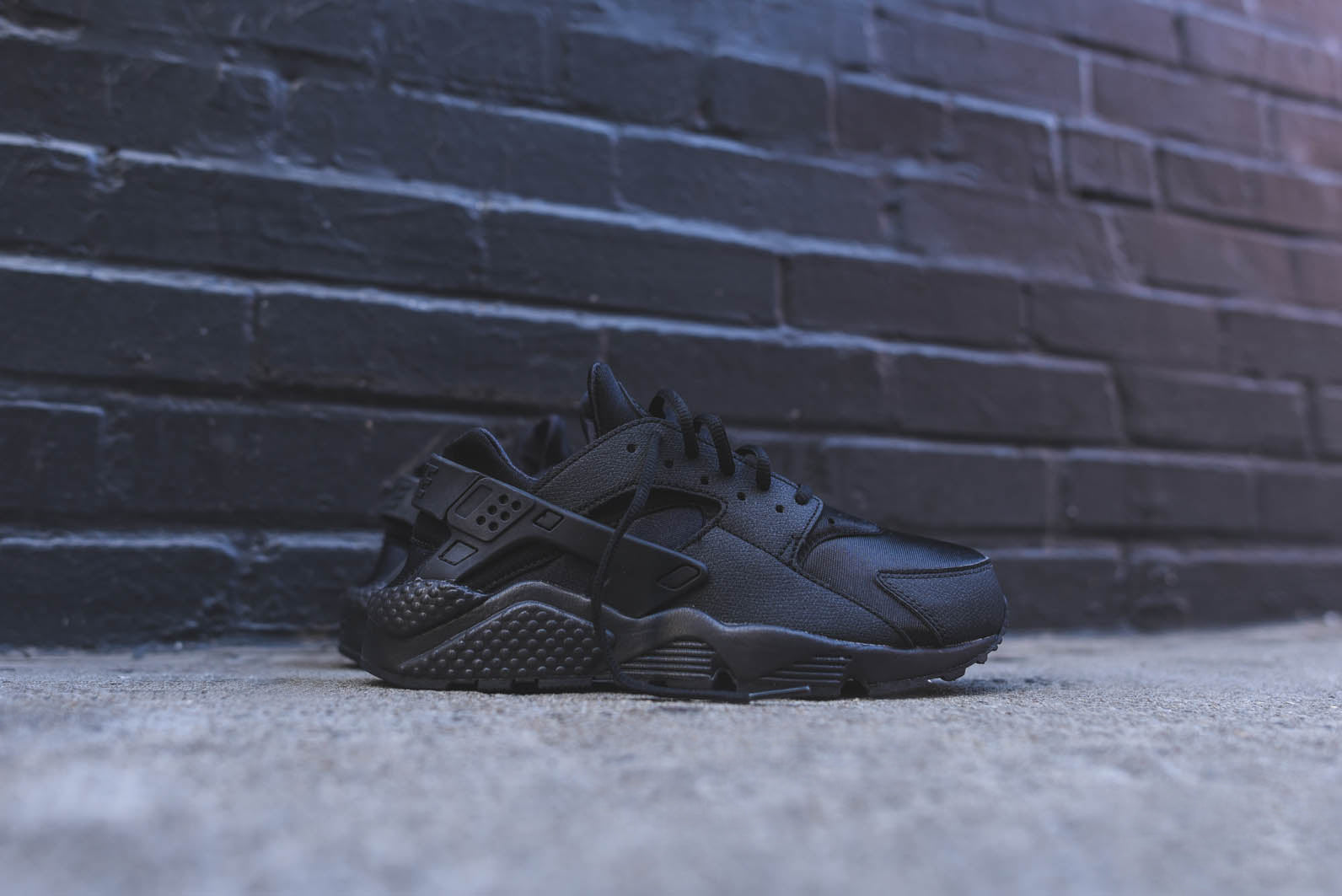 b8f3f5be8ddc The Nike WMNS Air Huarache Run - Triple Black   Sport Fuchsia are available  now for email order at KITH Manhattan.