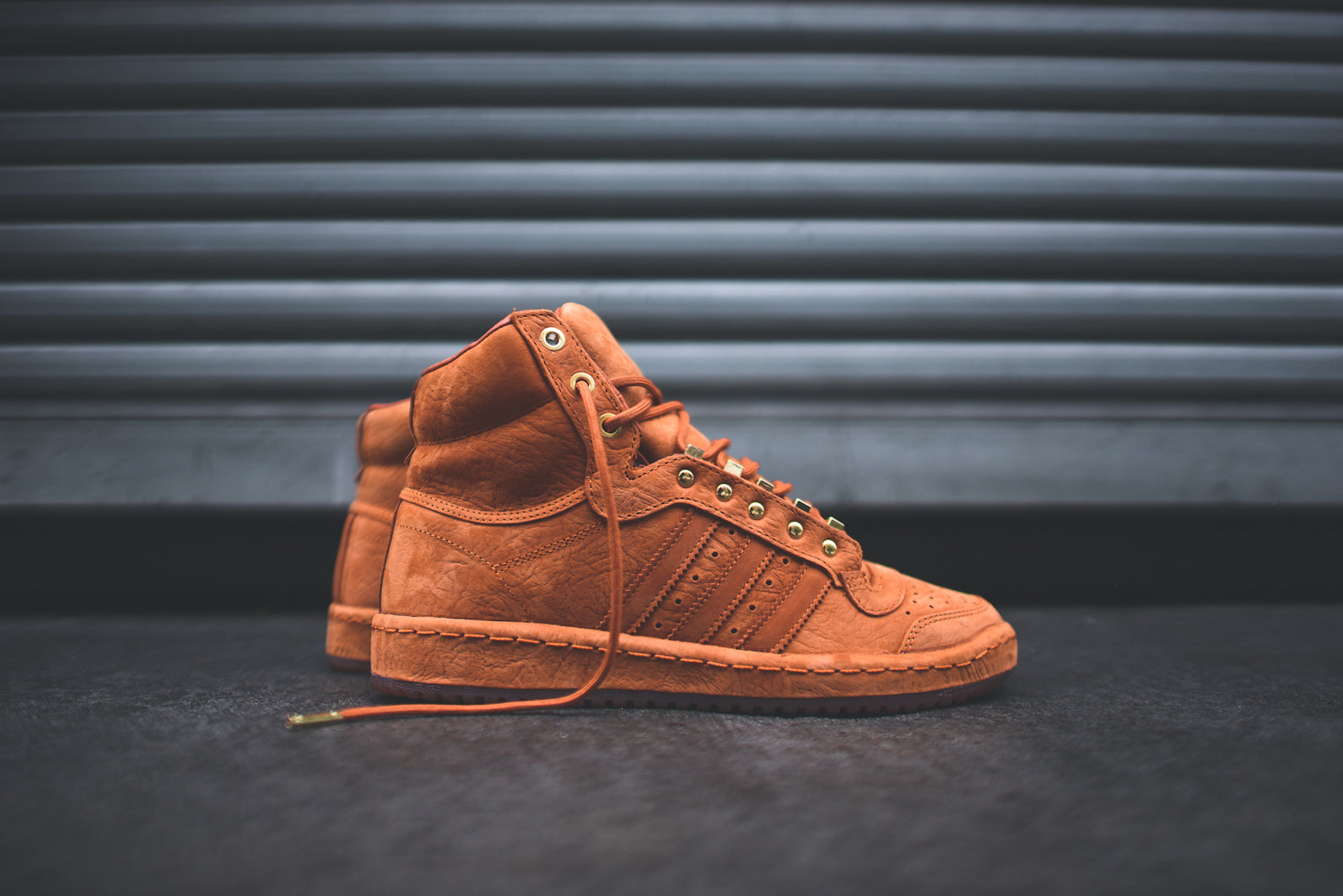 The adidas Originals Top Ten Hi - Fox Red is available now at both KITH  locations and online at KithNYC.com.