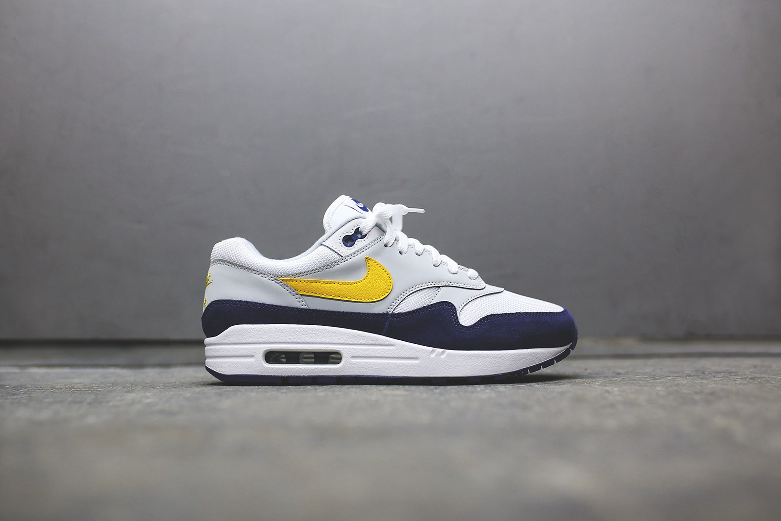 073c6aebd069 Nike Air Max 1 - White   Yellow   Blue – Kith