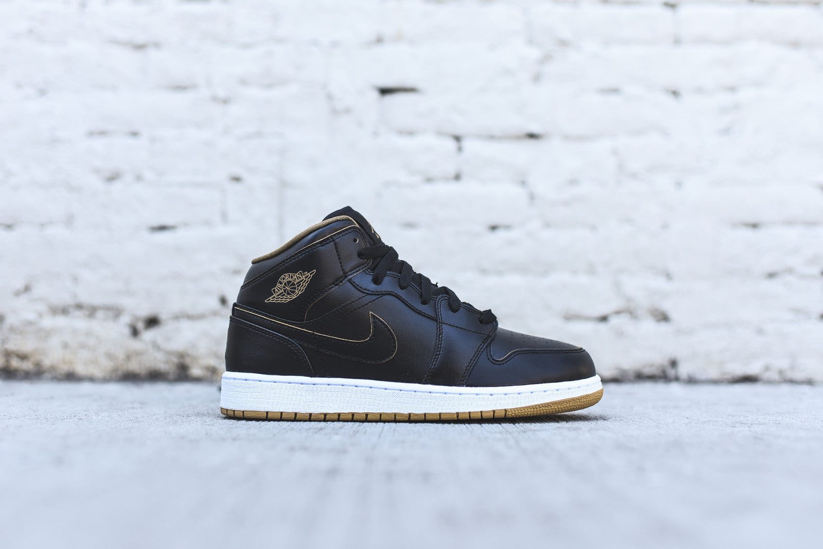 Nike Air Jordan 1 Mid GS - Black / Metallic Gold