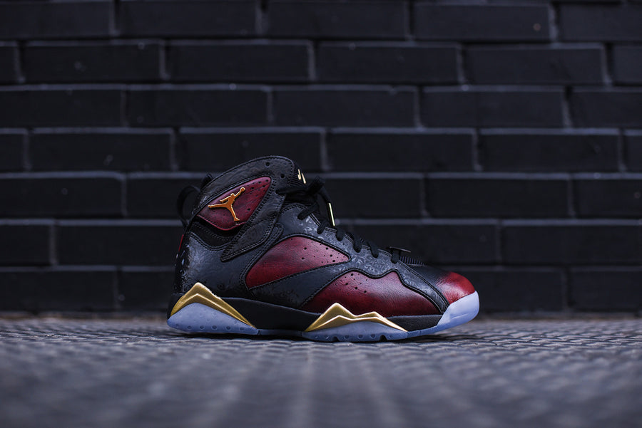 Nike GS Air Jordan 7 Retro Doernbecher - Black / Metallic Gold / University Red