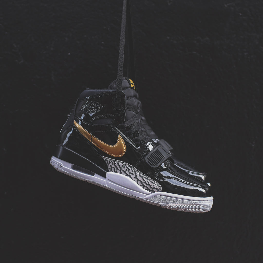 6e3a96067d15 Nike Air Jordan Legacy 312 - Black   Metallic Gold   White – Kith