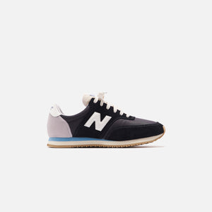 New Balance COMP 100 - Black / Wax Blue Image 1