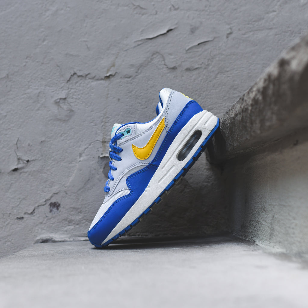 official photos 887e9 8eaf2 Nike Grade School Air Max 1 - Sail   Amarillo   Pure Platinum   Signal –  Kith