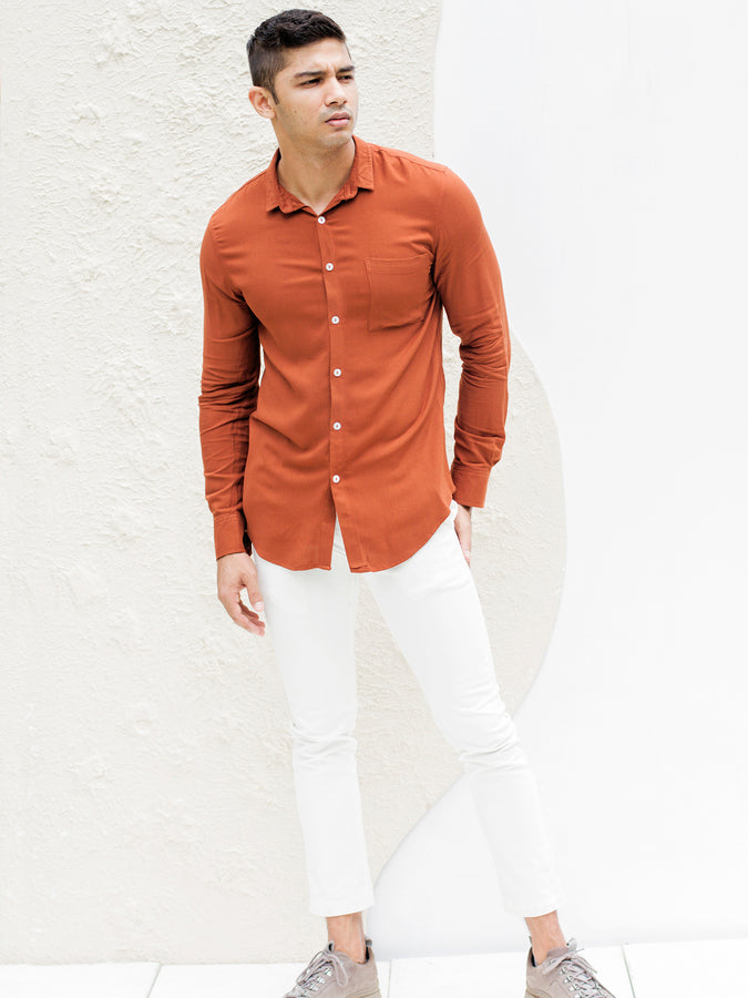 Long sleeved regular collar shirt with slouchy pocket detail