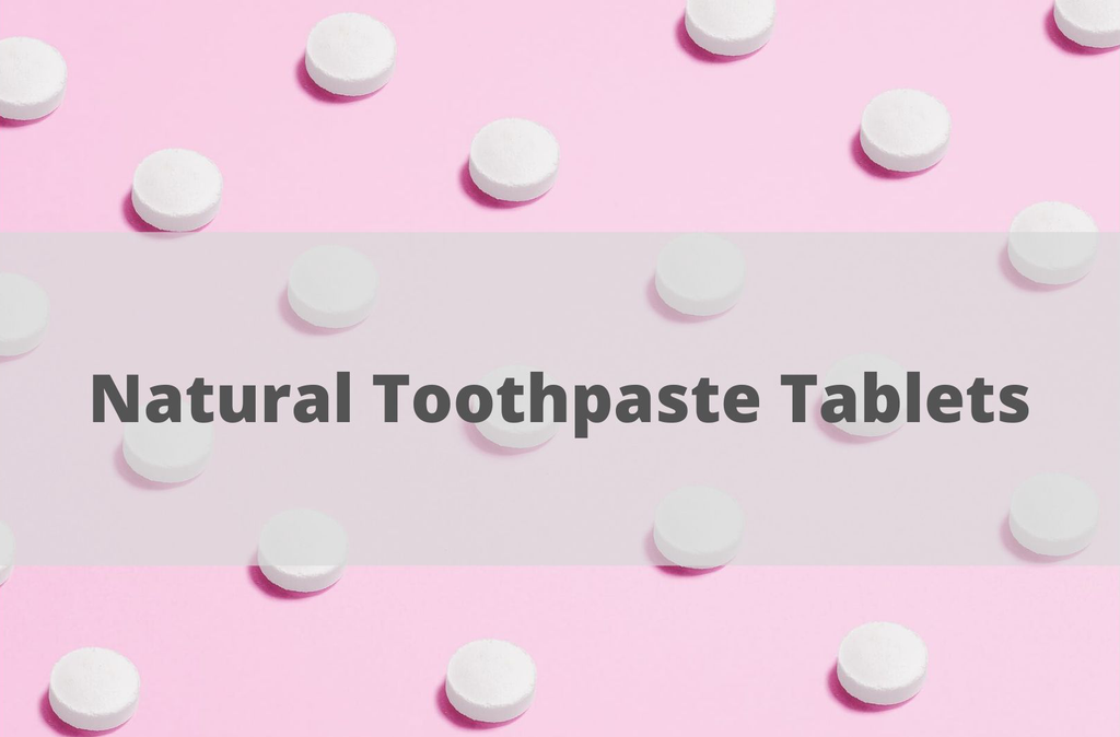 toothpaste tablets on pink background