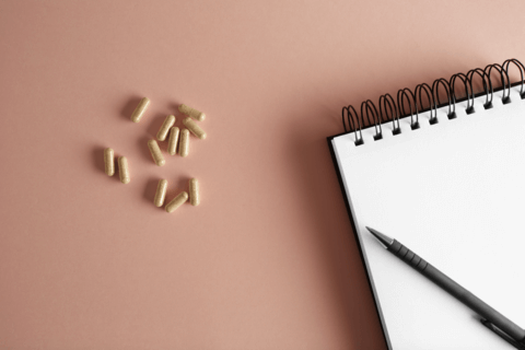 taking supplements correctly: notepad and capsules