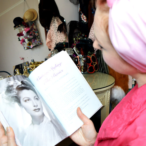 Miss Dupenny with Beauty Book
