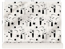 Load image into Gallery viewer, fabric roll with atomic fifties design in black and white