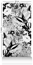Load image into Gallery viewer, wallpaper roll with floral garden design in black and white