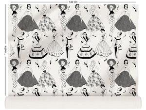 fabric roll with vintage dresses and ladies fashion in monochrome