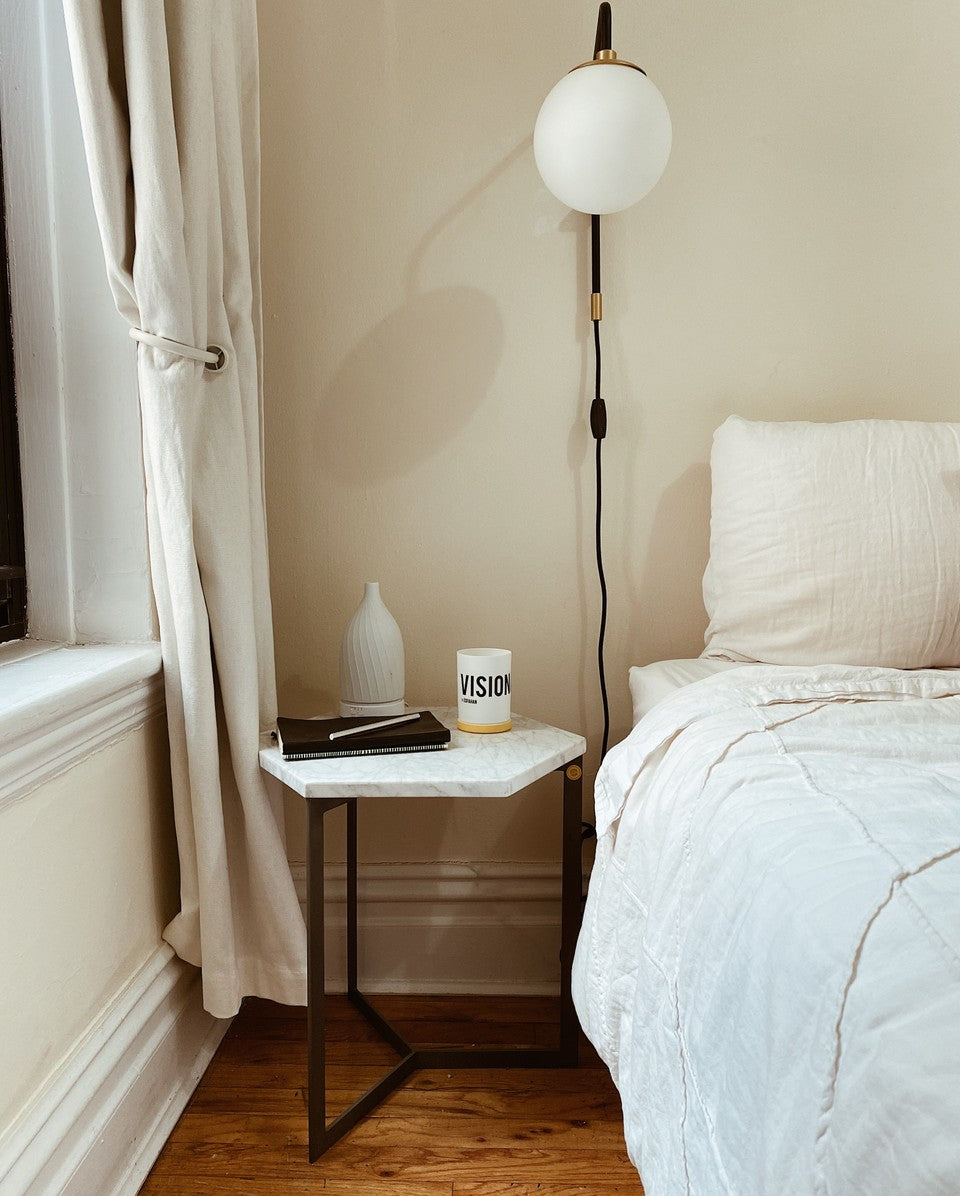 Nomad Noe Candle in Bedroom