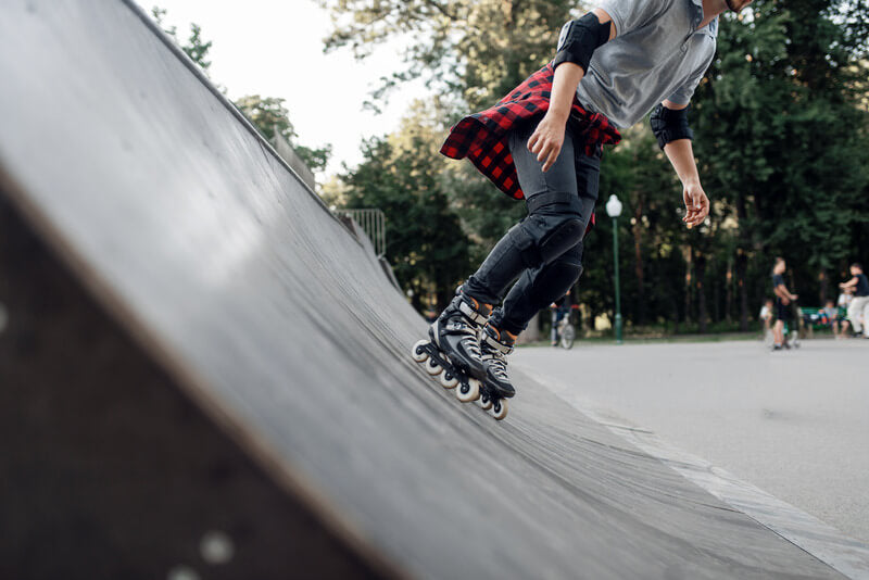 Young-Skater-Rolling-off-the-Ramp