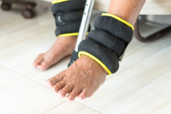 elderly-exercising-with-ankle-weights-for-strengthening-legs