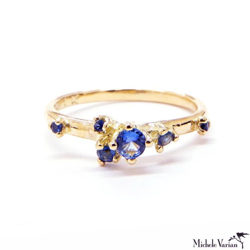 Sapphire Spurs Gold Ring