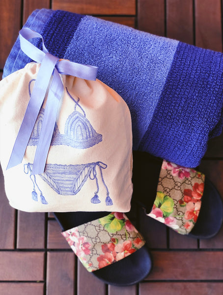 Izzie bag, a perfect travel accessory, is handmade using 100% cotton.