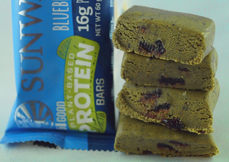 Blueberry Blast single protein bar unwrapped four pieces closeup on blueberries