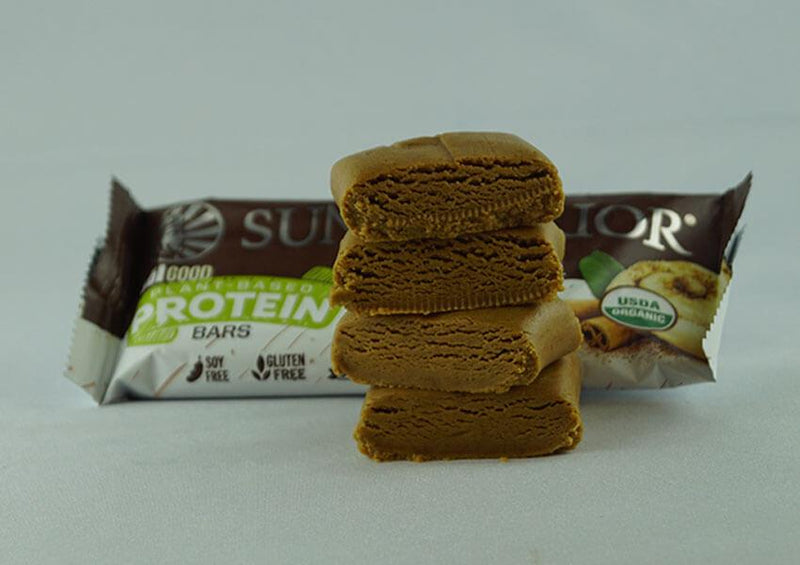 Cinnamon Roll single protein bar unwrapped four pieces