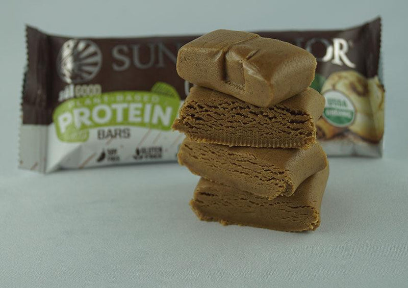Cinnamon Roll single protein bar unwrapped four pieces side view