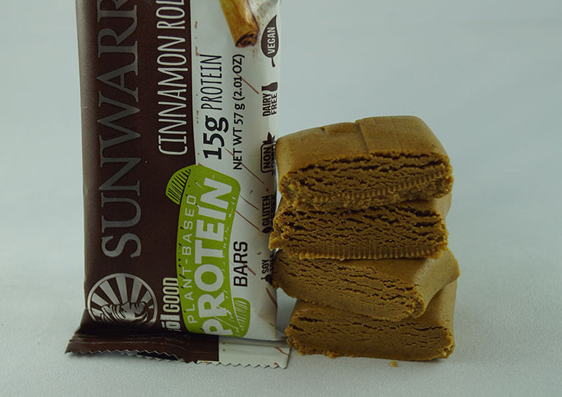 Cinnamon Roll single protein bar unwrapped four pieces closeup
