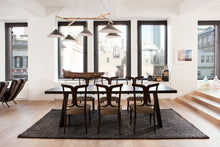 Load image into Gallery viewer, Emily Group of Five handmade sheet metal chandelier in black, with an oak timber frame and textile cables in a stylish New York City apartment