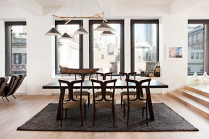 Emily Group of Five handmade sheet metal chandelier in black, with an oak timber frame and textile cables in a stylish New York City apartment