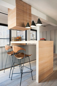 Emily III handmade sheet metal pendant lamp, semi-matte black grey painted with textile cable in a modern New York City design penthouse