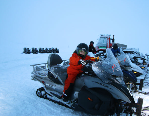 Jake on the snowmobile in Iceland