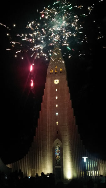 Fireworks on New Years Eve at Hallgrimskirkja Church in Reykjavik Iceland