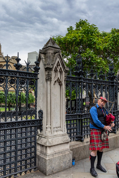 Random Bagpiper in Front of Westminster Abbey in London