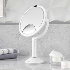 sensor mirror trio - white finish - lifestyle mirror on counter with makeup pads