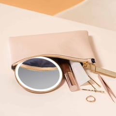 sensor mirror compact 10x - rose gold finish - lifestyle with cosmetics
