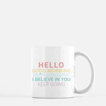 Load image into Gallery viewer, white ceramic mug with unicorn colors writing saying Hello. Good Morning. You're doing great. I believe in you. Keep going. plain white background