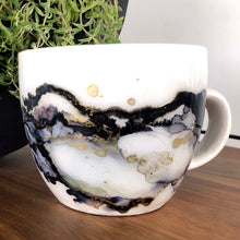 Load image into Gallery viewer, right view Midnight black and gold alcohol ink hand-painted on 16oz stoneware coffee mug. Signed by the artist, Jaylin Knutson.