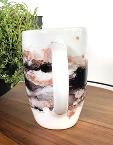 handle Variety of midnight black hues and copper alcohol ink hand-painted on 20 oz porcelain coffee mug. Signed by the artist, Jaylin Knutson.
