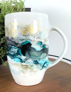 right view Sea teal, midnight black, and copper alcohol ink hand-painted on 20 oz porcelain coffee mug. Signed by the artist, Jaylin Knutson.